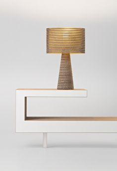 Book shelves, coffee table, low seating - oh and a cardboard table lamp. Simple and beautiful.