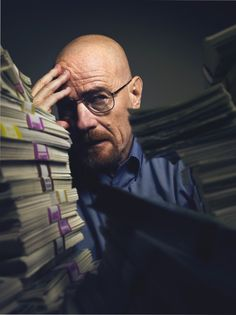 Bryan Cranston.  Looks like he's confused about the stacks of cash.  Wish I had that problem!
