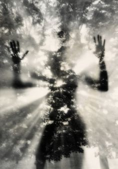 This picture reassembles a soul which wants to return to life. With the slighty blur shot with was taken as the person stands in the center gives an imaginary view - Ruth Bernhard