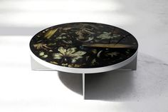 London-based Marcin Rusak's series of resin furniture, patterned with leaves and flowers trapped in the surfaces, is on show in New York's Chelsea.