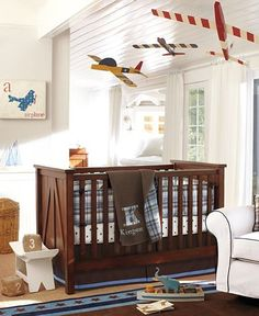 airplane nursery - I saw an airplane shelf at a craft fair that would go good with this.  Wings were shelf, and in middle protruded the body front w/ tiny spinning propeller.