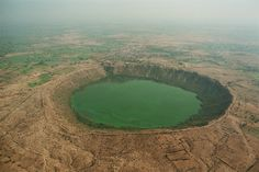 The Lonar Lake is a saline soda lake located at Lonar in Buldana district, Maharashtra, India which was created by a meteor impact.