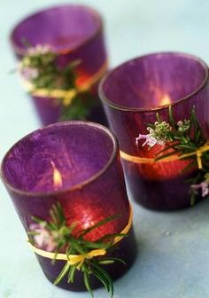 A little ribbon or string and some greenery go a long way in dressing up candle holders