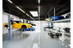 A Stunning Garage: Speedshop Type One by Torafu Architects : Speedshop Type One is an auto repair shop that was recently given a makeover by Torafu Architects. Led Garage Lights, Led Shop Lights, Shop Lighting, Mechanic Shop, Mechanic Garage, Motorcycle Garage, Garage Shop, Car Garage, Garage Light Fixtures