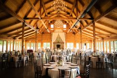 The main ballroom at The Pavilion at Carriage Farm doubles as a reception and ceremony hall. The room has a lodge feel with wooden details that make this spot very rustic-chic.