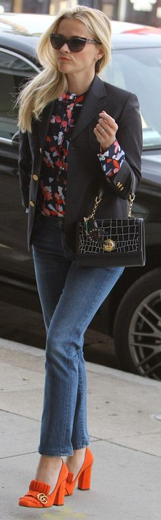 Who made  Reese Witherspoon's orange suede pumps, floral top, blue jacket, and handbag?