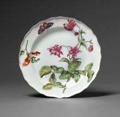 A fine Chelsea Hans Sloane botanical pate painted with an aquilegia and a small stem of snapdragons. Circa 1755. Diameter: 20.25 cm (8 in) From Robyn Robb