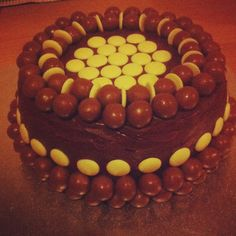 Chocoholic cake made for a friend's Birthday decorated with maltesers and white buttons