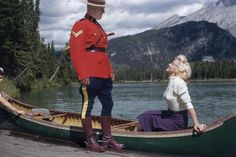 "This photo, from the exhibit ""Marilyn: The Lost Photos,"" was taken in 1953 in Banff, Canada, during the filming of the movie ""River of No Return,"" starring Marilyn Monroe and Robert Mitchum. That's a real Mountie."