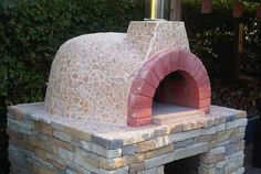 Fornino pizza oven covered with lovely mosaic