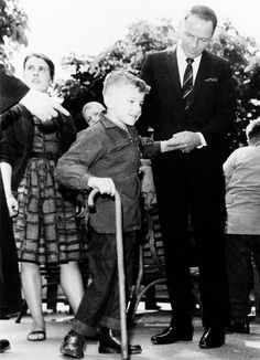 Frank Sinatra visits with handicapped children in England during his 1962 World Tour for Children.
