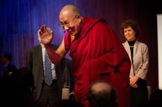 """The Dalai Lama sat quietly on stage in his maroon robe silently nodding his head. He said even though he doesn't have children, all of humanity's children will be affected by climate change.  """"We have the responsibility to think about their future, their life,"""" he said."""