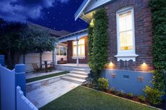 An Australian older style Federation era house at night with the lights on. Built circa 1910 in Sydney, Australia.
