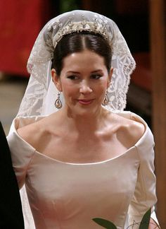 Crown Princess Mary of Denmark in her wedding dress and vail with crown. Lovely raised collar creates a pretty cameo of her face.