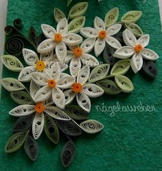 It's fun.....just rolled strips of paper shaped into flowers.                                                                                                                                                                                 Mais
