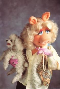 Miss Piggy and her poodle Foofoo. #celebrities #dogs www.bitchnewyork.com