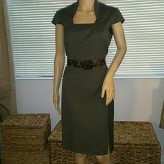 New Antonio Melani khaki dress and belt Beautifully made. Purchased this out if town, unable to  try on or return . .fits a 1.5 inches above knee inches above  Price is firm  as it is $100 less than I paid ANTONIO MELANI Dresses