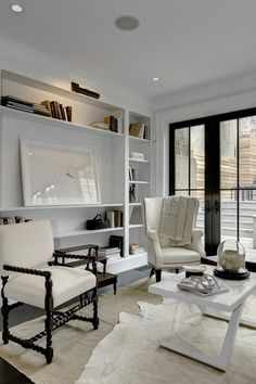 An elegant family room. Artwork by The Art Registry, interiors by Darryl Carter Boutique.