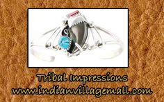 Wire Bracelet- Navajo made- Turquoise And Red Coral Stones- On Sterling Sliver- Navajo Made- Review the collection off of: http://www.indianvillagemall.com/jewelry/bearclaw.html