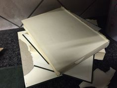 Remove inside of books, and for books placed between others, cut sides of hardcover