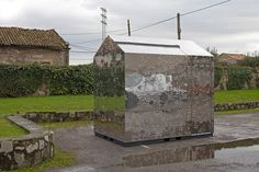 Hightly reflective material means that this temporary kiosk almost looks invisible.