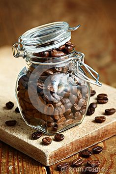 Roasted coffee beans in a clear glass jar