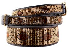 Beads are hand sewn in leather and then an overlay of leather is glued and stitched on the back. Buckles are hand-cast brass. The beading is done by Maasai 'mamas' working in their home area; they can earn a living while maintaining their rural lifestyle.