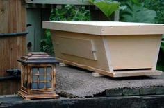 BackYardHive top bar bee hive - easier method for beekeeping, may not produce as much honey as Langstrom method, but has less parts and is probably less expensive, Top Bar Hive method also called the Kenya Hive