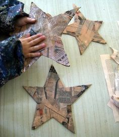 paper mache stars, paint, paper collage, photos...