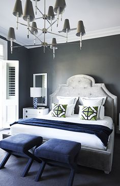 Greg Natale design. Charcoal walls, light grey upholstered bed and navy accents.