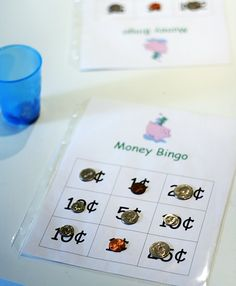 """take turns picking a coin from the cup and placing it on the matching value.  If you don't have any more spaces for the coin you chose, put it back and lose a turn.  First person to get three-in-a-row says, """"Bingo!"""""""