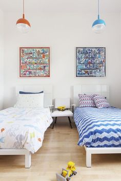 Ann Lowengart Interiors Modern Kids Room with two twin beds and framed art prints