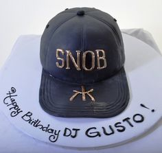 """For that person in your life who cannot get enough of """"the good life"""", here you go! This design is a perfect fit for the self-proclaimed """"snob"""" – a hand-shaped replica of a black leather baseball cap, emblazoned with """"SNOB"""" and the logo for the new, chic, and exclusive Hakkasan night club at the MGM Grand Hotel in Las Vegas."""