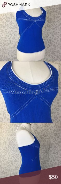"""Armani Exchange A/X blue halter sweater tank top Royal blue with white stitching and little cutouts. Adjustable halter tie neck.  Gently preloved.  Approximate flat lay measurements: Length: 19"""" from top of triangle to hem. Bust across pit to pit: 13.5"""" A Armani Exchange Tops Tank Tops"""