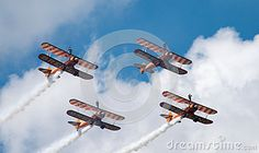 Four Breitling wing walker planes in formation at Farnborough airshow 2016