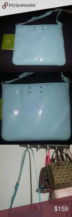 Authentic Kate Spade Crossbody Perfect condition! Gorgeous blue color with lazer cut out hearts. Adjustable strap for comfort. Authentic and will come with care booklet. Carried just a couple times.  The outside is not made of cloth,  it's more like a shiny material. No flaws!!.  Available to trade. Just ask! 🤗😆🤓  Rare crossbody!! I got many compliments on this when I carried it. The color is gorgeous!! kate spade Bags Crossbody Bags