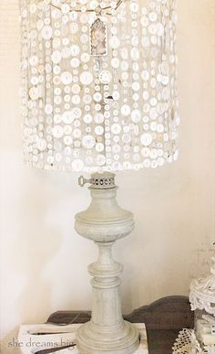 a lampshade made of button stings....something to do with all Grandmas buttons!