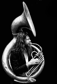 thephotographerssociety:  photowilliams:  Sousaphonist  Excellent portrait work. The total black background emphasises the man with the instrument. Yiannis