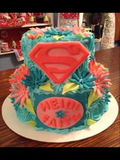 Pink and Turquoise Superman Cake by Sweet Flour Bake Shoppe