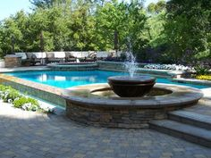 Enjoy your swimming pool right from the patio with a variety of water features. Check out these fountains, waterfalls and swim-up bars for some outdoor design ideas and inspiration. Backyard Pool Landscaping, Swimming Pools Backyard, Swimming Pool Designs, Landscaping Ideas, Backyard Plants, Deck Patio, Swimming Pool Waterfall, Pool Water Features, Pool Fountain