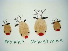Handmade Reindeer Family Christmas Card - with thumb prints of every member of the family decorated as reindeer.