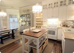 LOVE these floors and obvi the white kitchen and fancy lighting. Don't love the white appliances -- stainless people!