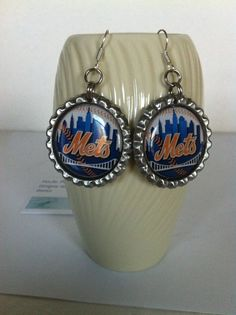 Check out this item in my Etsy shop https://www.etsy.com/listing/250234885/new-york-mets-earrings-baseball-gift-for