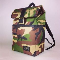 The Camo Backpack. Black leather trim and shoulder straps with brass buckle.   From $220.00 MotleyGoods.com   #custombackpack
