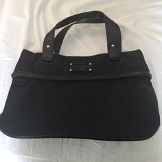 Kate Spade Black Bag with Dust Case Black Kate Spade Bag into plenty of room inside 2 zippered inside compartments as well as pouches for phones. Willing to negotiate kate spade Bags