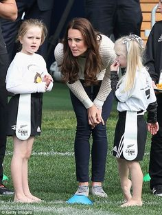 The sporty duchess was keen to talk tactics with some of her young players #katemiddleton