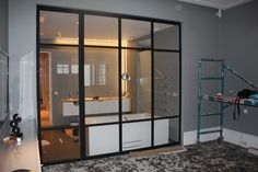 Painted black mat, metal doors with clear glass and hidden hinges. its simplicity perfectly fit to almost every interior. Realization by Zbigniew Bakanowicz Oslo - Norway Hidden Hinges, Metal Doors, Oslo, Clear Glass, Norway, Divider, Fit, Interior, Room