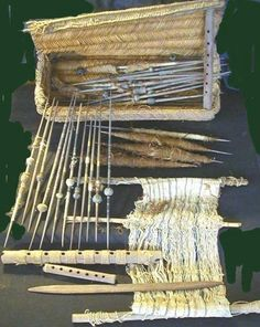 Chancay   weaver's toolbox   reed basket containing: ~40 spindles (most painted, with incised & painted whorls) + small weaving attached to wood rods + loom parts + flat weaving tool + loose whorls   Peru   c. 1100–1450 AD