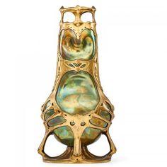 FRIEDRICH ADLER (1878 - 1942)ZSOLNAYFine sculptural Art Nouveau mounted vase, Austria, early 20th C. Eosin-glazed earthenware, gilt metal Metal