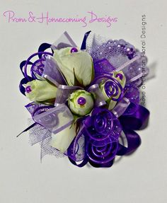 A collection of prom and homecoming boutonnieres and corsages designed by Rose of Sharon Floral Designs